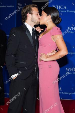 Stock Image of Henri Esteve and Gina Rodriguez attend the 2015 White House Correspondents' Association Dinner at the Washington Hilton Hotel, in Washington