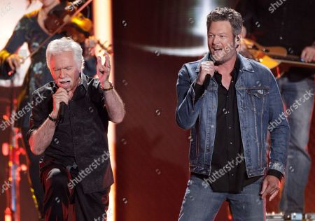 Joe Bonsall, left, of the Oak Ridge Boys, and Blake Shelton perform at the CMT Music Awards at the Bridgestone Arena, in Nashville, Tenn