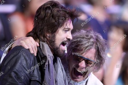 Billy Ray Cyrus, left, and Tom Petersson, of Cheap Trick, are seen at the CMT Music Awards at the Bridgestone Arena, in Nashville, Tenn