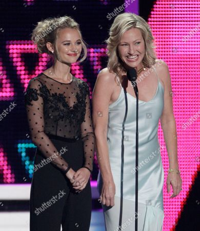 Madison Iseman, left, and Joey Lauren Adams appear on stage at the CMT Music Awards at the Bridgestone Arena, in Nashville, Tenn