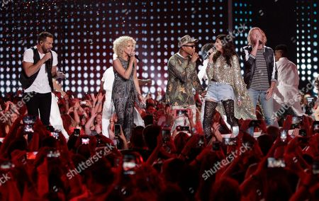 Stock Picture of Pharrell Williams, third from left, and Little Big Town perform One Dance at the CMT Music Awards at the Bridgestone Arena, in Nashville, Tenn. From left are, Jimi Westbrook, Kimberly Roads Schlapman, Pharrell Williams, Karen Fairchild and Phillip Sweet
