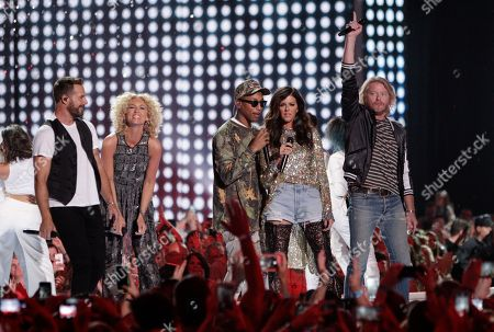 "Pharrell Williams, center, and Little Big Town, from left, Jimi Westbrook, Kimberly Roads Schlapman, Williams, Karen Fairchild and Phillip Sweet, perform ""One Dance"" at the CMT Music Awards at the Bridgestone Arena, in Nashville, Tenn. From"