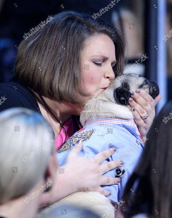 "Candace Payne, also known as ""Chewbacca Mom, kisses Doug the Pug at the CMT Music Awards at the Bridgestone Arena, in Nashville, Tenn"