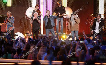 Blake Shelton, center, and The Oak Ridge Boys perform at the CMT Music Awards at the Bridgestone Arena, in Nashville, Tenn. From left are Duane Allen, Joe Bonsall, Blake Shelton, William Lee Golden and Richard Sterban