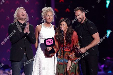 Stock Photo of Little Big Town, from left, Phillip Sweet, Kimberly Roads Schlapman, Karen Fairchild and Jimi Westbrook accept the award for group/duo video of the year for Girl Crush at the CMT Music Awards at the Bridgestone Arena, in Nashville, Tenn