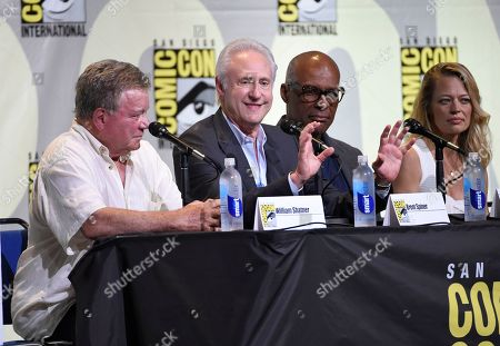 """William Shatner, from left, Brent Spiner, Michael Dorn, and Jeri Ryan attend the """"Star Trek"""" panel on day 3 of Comic-Con International, in San Diego"""