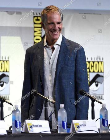 "Scott Bakula walks onstage before the start of the ""Star Trek"" panel on day 3 of Comic-Con International, in San Diego"