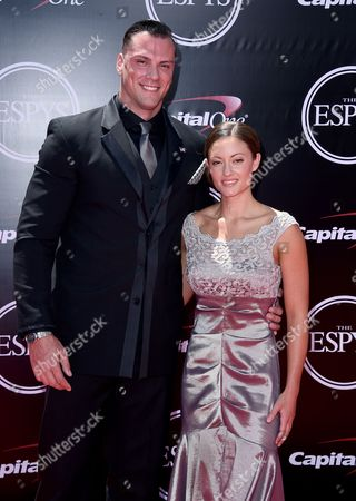 Colton Wasil, left, and Elizabeth Marks, paralympic swimmer and sergeant in the United States military, right, and xxx arrive at the ESPY Awards at the Microsoft Theater, in Los Angeles