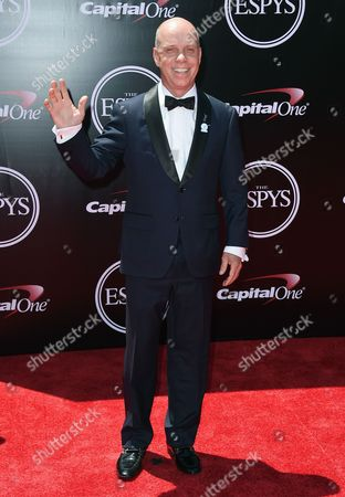 Sports commentator Scott Hamilton arrives at the ESPY Awards at the Microsoft Theater, in Los Angeles