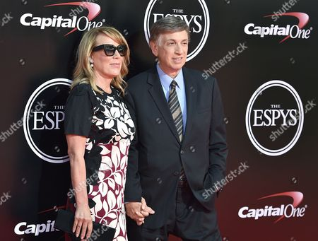 Heather Faulkiner, and, Marv Albert arrives at the ESPY Awards at the Microsoft Theater, in Los Angeles