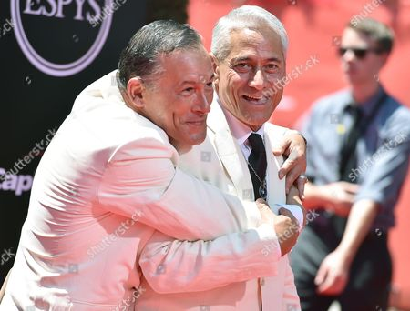 Johnny Chaillot, left, and diver Greg Louganis arrive at the ESPY Awards at the Microsoft Theater, in Los Angeles