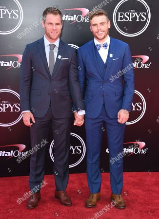 Matthew Wilkas, left, and freestyle skier, Gus Kenworthy arrive at the ESPY Awards at the Microsoft Theater, in Los Angeles
