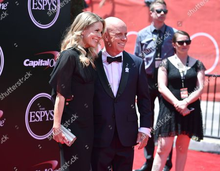 Sports commentator Scott Hamilton, right, and Tracie Hamilton arrive at the ESPY Awards at the Microsoft Theater, in Los Angeles