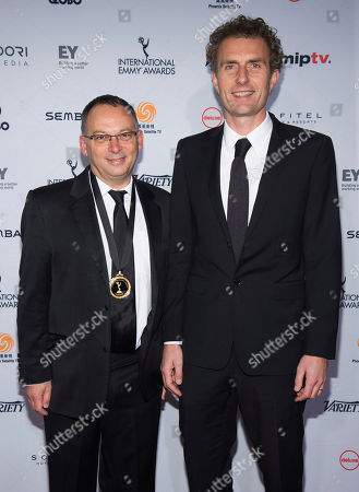 Stock Picture of Derek Wax, left, and Euros Lyn attend the 44th International Emmy Awards at the New York Hilton, in New York