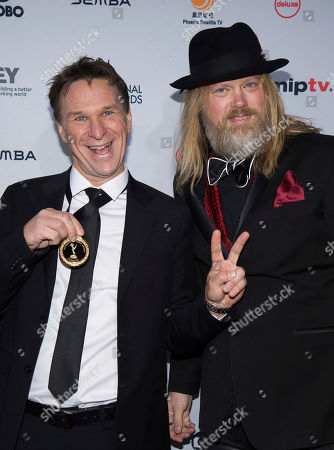 Stock Photo of Christer Akerlund and Anders Lundin attend the 44th International Emmy Awards at the New York Hilton, in New York