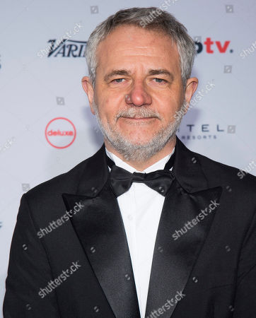 Stock Photo of Carlos Henrique Schroder attends the 44th International Emmy Awards at the New York Hilton, in New York
