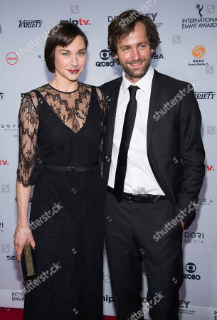 Christiane Paul and Florian Stetter attend the 44th International Emmy Awards at the New York Hilton, in New York
