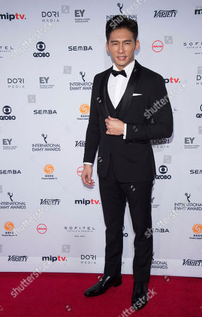 Stock Photo of James Wen attends the 44th International Emmy Awards at the New York Hilton, in New York