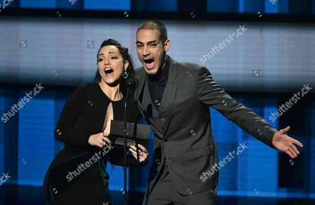 Sharlene Taule, left, and Michel Duval present the award for favorite pop/rock band/duo/group at the Latin American Music Awards at the Dolby Theatre, in Los Angeles