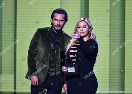 Fabian Rios, left, and Chiquis Rivera present the award for favorite regional Mexican song at the Latin American Music Awards at the Dolby Theatre, in Los Angeles