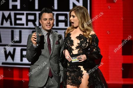 Karim Mendiburu, left, and Carmen Aub present the award for new artist of the year at the Latin American Music Awards at the Dolby Theatre, in Los Angeles