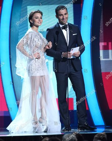 Angelique Boyer and Miguel Angel Sylvestre present the award for best urban fusion performance at the 17th annual Latin Grammy Awards at the T-Mobile Arena, in Las Vegas
