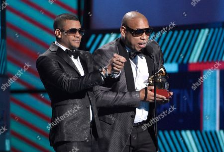 """Randy Malcom Martinez, left, and Alexander Delgado, of Gente de Zona, accept the award for best tropical fusion album for """"Visualizate""""at the 17th annual Latin Grammy Awards at the T-Mobile Arena, in Las Vegas"""