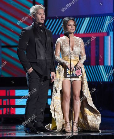 "Stock Photo of Jesus ""Chino"" Miranda, left, and Becky G present the award for best tropical song at the 17th annual Latin Grammy Awards at the T-Mobile Arena, in Las Vegas"
