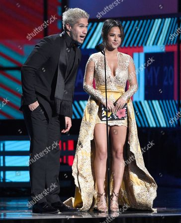"Jesus ""Chino"" Miranda, left, and Becky G present the award for best tropical song at the 17th annual Latin Grammy Awards at the T-Mobile Arena, in Las Vegas"