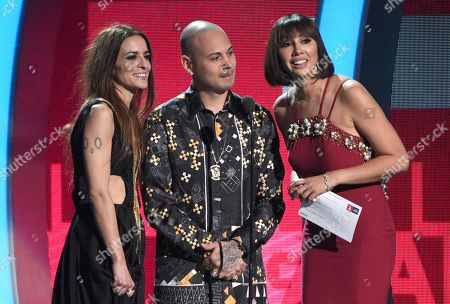 Bebe, from left, Jacob Forever and Jackie Cruz present the award for best contemporary pop vocal album at the 17th annual Latin Grammy Awards at the T-Mobile Arena, in Las Vegas