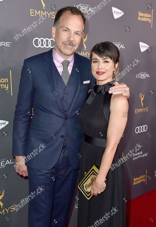 Constance Zimmer, right, and Russ Lamoureux arrive at the Performers Nominee Reception presented by the Television Academy at the Pacific Design Center, in West Hollywood, Calif