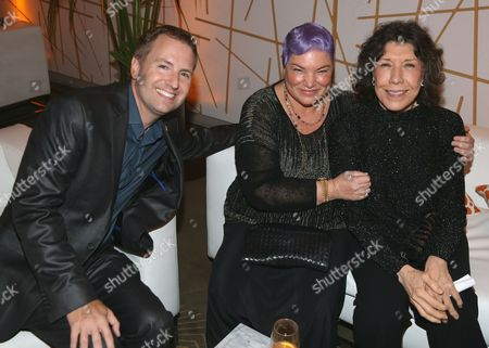 Maury McIntyre, president and COO, from left, Mindy Cohn and Lily Tomlin attend the Performers Nominee Reception presented by the Television Academy at the Pacific Design Center, in West Hollywood, Calif