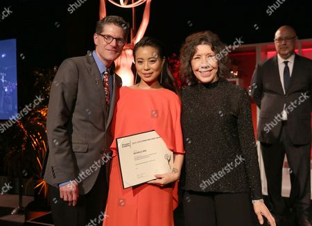 Bob Bergen, from left, Emmy nominee Michelle Ang, and Lily Tomlin attend the Performers Nominee Reception presented by the Television Academy at the Pacific Design Center, in West Hollywood, Calif