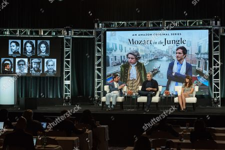 """Executive Producer Roman Coppola, from left, Executive Producer Paul Weitz, and Lola Kirke participate in the """"Mozart in the Jungle"""" panel during the Amazon Television Critics Association summer press tour, in Beverly Hills, Calif"""