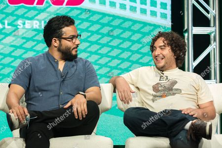 """Ennis Esmer, left, and Oliver Cooper participate in the """"Red Oaks"""" panel during the Amazon Television Critics Association summer press tour, in Beverly Hills, Calif"""
