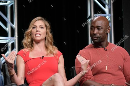"Tricia Helfer, left, and DB Woodside participate in the ""Gotham/Lucifer"" panel during the Fox Television Critics Association summer press tour, in Beverly Hills, Calif"