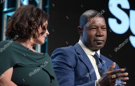 "Julia Ormond, left, and Dennis Haysbert participate in the Syfy network's ""Incorporated"" panel during the NBCUniversal Television Critics Association summer press tour, in Beverly Hills, Calif"