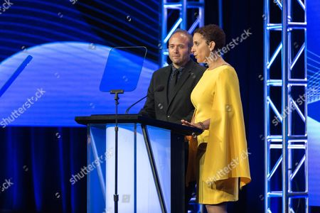 Jarett Wieselman, left, and Melanie McFarland present the award for Individual Achievement in Drama at the 32nd Annual Television Critics Association Awards Show at the Beverly Hilton, in Beverly Hills, Calif