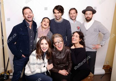 """Director Alex Ross Perry, top center, poses with actors, from left, Nick Kroll, Jenny Slate, Jeff Baena, Brett Gelman, Alison Brie, Lauren Weedman, and Lisa Edelstein for a portrait to promote the film, """"Joshy"""", at the Toyota Mirai Music Lodge during the Sundance Film Festival, in Park City, Utah"""