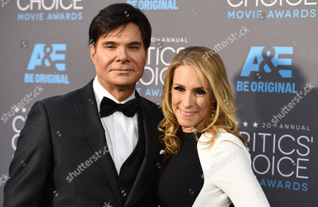 Eric Schiffer, left, and Dr. Jenn Berman arrive at the 20th annual Critics' Choice Movie Awards at the Hollywood Palladium, in Los Angeles