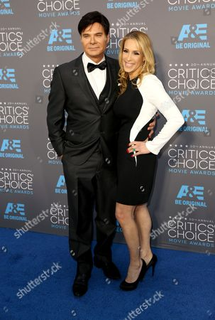 Stock Image of Eric Schiffer, left, and Dr. Jenn Berman arrive at the 20th annual Critics' Choice Movie Awards at the Hollywood Palladium, in Los Angeles