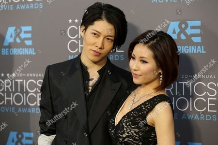 Takamasa Ishihara, left, and Melody Miyuki arrive at the 20th annual Critics' Choice Movie Awards at the Hollywood Palladium, in Los Angeles