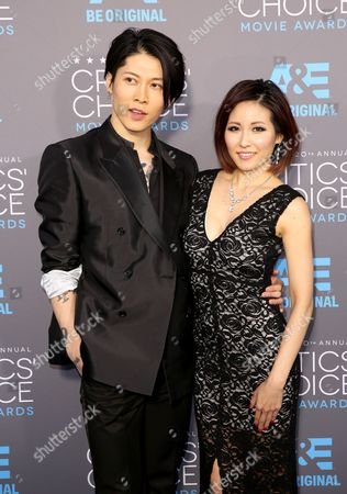 Takamasa Ishihara, left, and Melody Miyuki Ishikawa arrive at the 20th annual Critics' Choice Movie Awards at the Hollywood Palladium, in Los Angeles