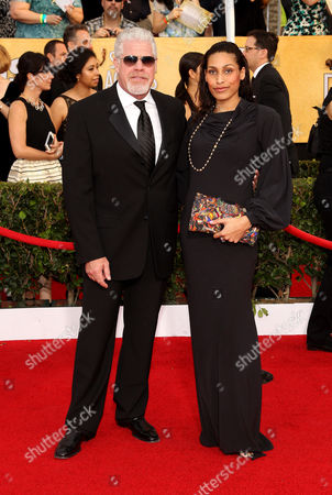 Ron Perlman, left, and Opal Perlman arrive at the 20th annual Screen Actors Guild Awards at the Shrine Auditorium, in Los Angeles
