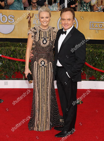 Stock Photo of Roberto Zincone, left, and Malin Akerman arrive at the 20th annual Screen Actors Guild Awards at the Shrine Auditorium, in Los Angeles
