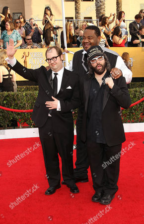 Stock Image of From left, John Lutz, Grizz Chapman and Judah Friedlander arrive at the 20th annual Screen Actors Guild Awards at the Shrine Auditorium, in Los Angeles