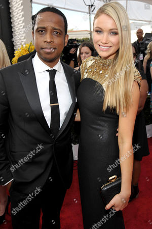 """Stock Image of Actor Keith Powell, left, and actress Katrina Bowden, right, from """"30 Rock"""" arrive to the red carpet at the 20th Annual Screen Actors Guild Awards, on in Los Angeles"""