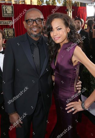 Forest Whitaker, left, and Keisha Nash Whitaker arrive at the 20th annual Screen Actors Guild Awards at the Shrine Auditorium, in Los Angeles
