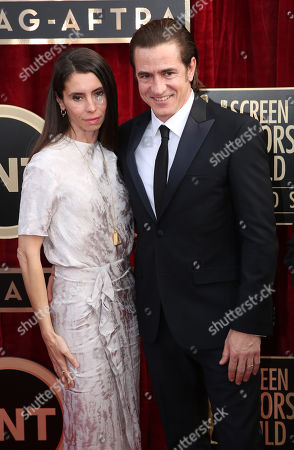 Tharita Catulle, left, and Dermot Mulroney arrive at the 20th annual Screen Actors Guild Awards at the Shrine Auditorium, in Los Angeles