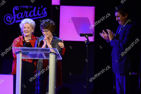Actors Millicent Martin, left, and Alfred Molina, right, present the Sargent and Eunice Shriver profiles in dignity award to Jill Gascoine at the 21st Annual 'A Night at Sardi's' to benefit the Alzheimer's Association at the Beverly Hilton Hotel on in Beverly Hills, Calif